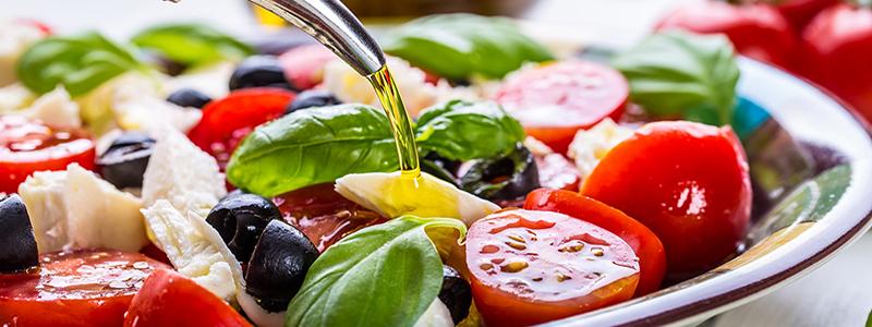 Caprese. Caprese salad. Italian salad. Mediterranean salad. Italian cuisine. Mediterranean cuisine. Tomato mozzarella basil leaves black olives and olive oil. Recipe - Ingredients
